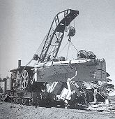 Steam Crane 23 at work, clearing the track after a derailment near wishbone in july 1976